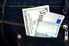 Money in jeans Stock Images