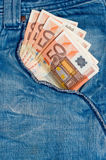 Money and jeans Royalty Free Stock Photos