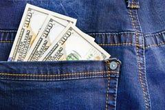 Money in  jeans Stock Photos