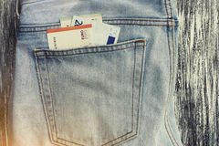 Money in a jeans pocket. Money euro in a jeans pocket. Lens flare effect Stock Photos