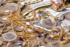 Money and jewels close view Royalty Free Stock Images