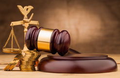 Money  and judge gavel  on table Stock Image