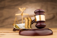 Money  and judge gavel  on table Royalty Free Stock Images