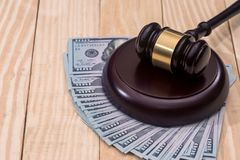 Money and judges hammer. On wooden table royalty free stock images