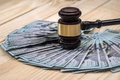 Money and judges hammer. On wooden table royalty free stock photo