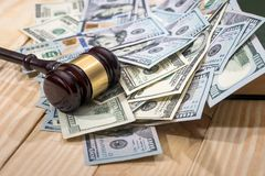Money and judges hammer. On wooden table stock image