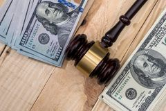 Money and judges hammer on wooden. Table royalty free stock images