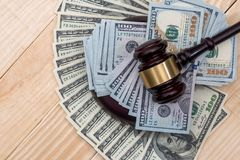 Money and judges hammer on wooden table.  stock images