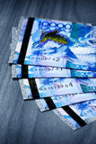 Money of Kazakhstan, banknotes tenge. Large denominations for a wooden table Royalty Free Stock Images