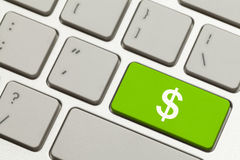 Money Key. Cluse Up of Green Money Key with Cash Symbol on a Keyboard Royalty Free Stock Image