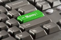Money key on computer keyboard. Enter button replaced with Money-button on a black keyboard Royalty Free Stock Image