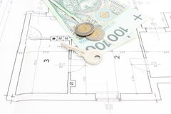 Money and key lying on the housing plan Royalty Free Stock Images