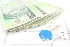 Money with key lying on the housing plan Stock Image