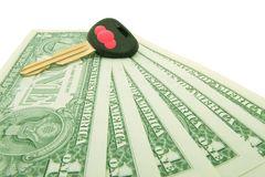 Money  and  key for new car. One dollar banknotes and automobile key, white backcloth Stock Photography