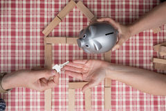 Money and key - safety and home expense concept an piggy bank Stock Image