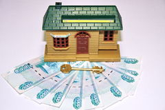 Money, the key and toy. Russian money, the key and toy house Royalty Free Stock Photos