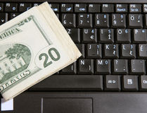 Money and keyboard Stock Images