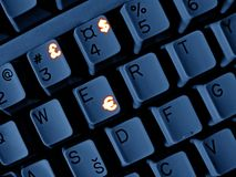 Money keyboard. Navy keyboard with glowing currency symbols stock photos