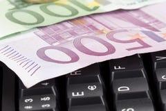 Money on a keyboard