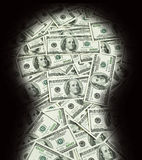 Money in the keyhole. Money in the dark keyhole Stock Photo