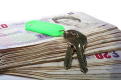 Money and keys Royalty Free Stock Photography