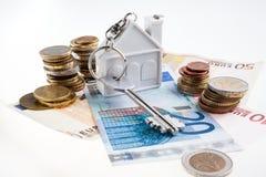 Money and keys. Royalty Free Stock Photos
