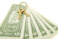 Money  and  keys for new house. One dolar banknotes, keys, white backcloth Royalty Free Stock Photo