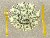 Money with knife and fork Royalty Free Stock Images