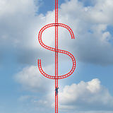Money Ladder. Success concept as a risk taker businessman climbing a red group of ladders shaped as a dollar symbol as a metaphor for financial gain or finance Stock Images
