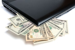 Money and laptop Stock Photos