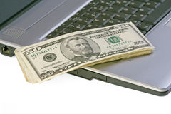 Money on laptop Stock Photos