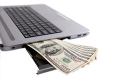 Money and laptop. Concept isolated in white background Stock Photo