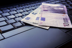 Money on laptop. The european union money on laptop stock photography