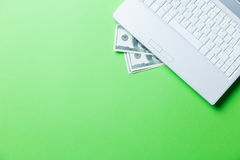 Money and laptop Royalty Free Stock Photos
