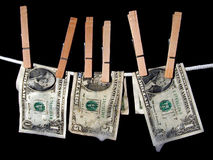 Money Laundering. Bills hanging out to dry Royalty Free Stock Image