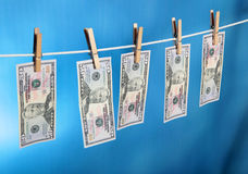 Money laundering. On a bright blue background Royalty Free Stock Photo