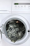 Money laundering. Concept - 100 dollar bills laundered in a washing machine Stock Images