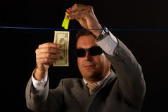 Money laundering. Mafia guy busy with some serious money laundering Royalty Free Stock Photos
