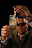 Money laundering. Mafia guy busy with some serious money laundering Royalty Free Stock Photo