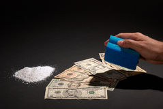 Money laundering. Cleaning dollar banknotes with scouring pad and washing powder, money laundry concept Stock Photo