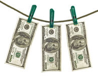 Money laundering. Dollars, dollars hang on a shoestring Royalty Free Stock Photography