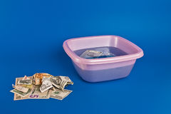 Money laundering. Money-laundering in house conditions Stock Images
