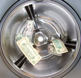 Money laundering. US Dollars shot in a washing machine money laundering Royalty Free Stock Images