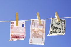Money laundering. Photo of money hanging on the clothesline on the blue sky royalty free stock photos