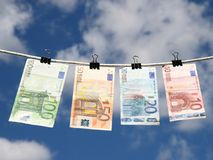 Money laundering. Euros drying up after cleaning (washing Royalty Free Stock Photo