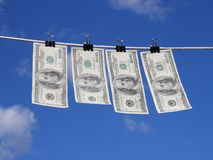 Money laundering. Dollars drying up after cleaning (washing Royalty Free Stock Photography