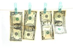 Money Laundering. USA or American currency on a laundry (wash) line isolated against white Royalty Free Stock Photo
