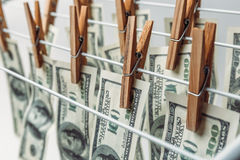Money laundering concept. American hundred dollar bills hanging to be dry and clean cash Stock Image