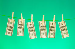 Money laundering concept with dollars. On the rope Stock Image