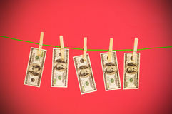 Money laundering concept with dollars. On the rope Royalty Free Stock Images